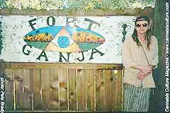Murli next to the Fort Ganja sign